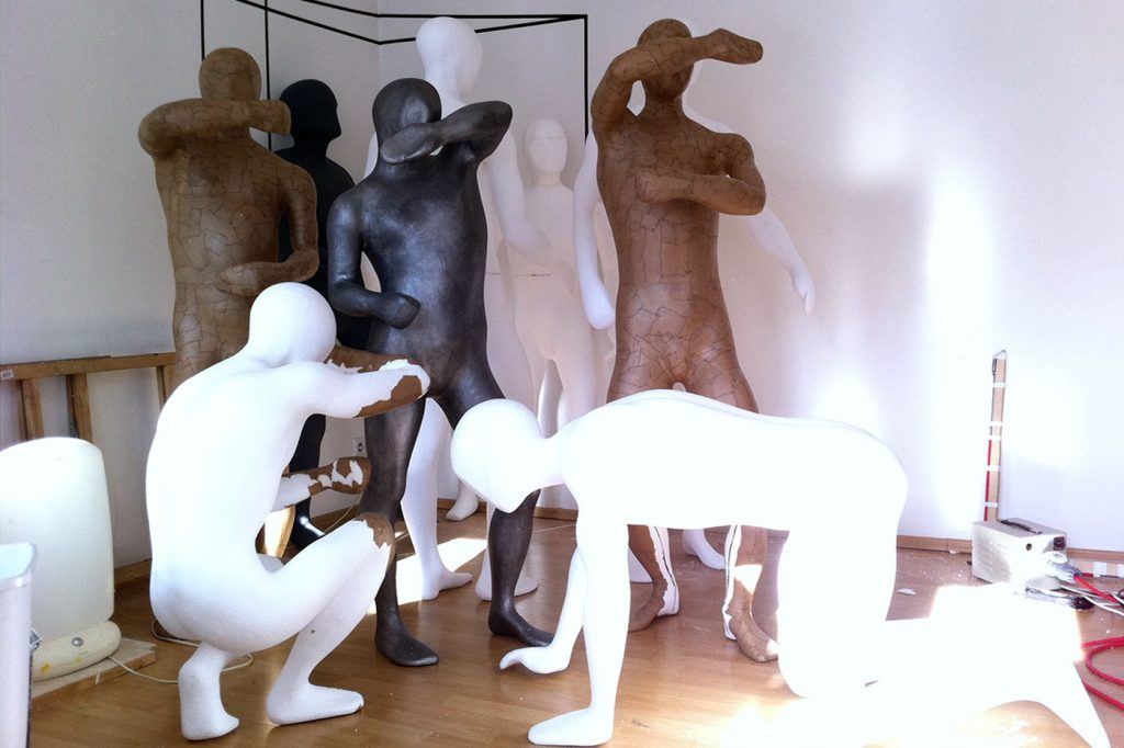 FIGURINE CIRCLE of 10 life-size figures,  © 2011 styrofoam, lined with paper, aluminium powder, acrylic paint, steel framework