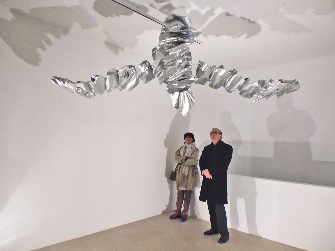 SWAN MOBILÉ,  © 2011-2013,  styrofoam, lined with paper, aluminium powder in acrylic, fishing line, ceiling motor, 50 x 320 x 220 cm