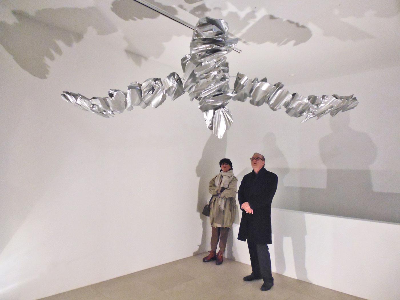 SWAN MOBILÉ,  © 2011-2013,  styrofoam, lined with paper, aluminium powder in acrylic, fishing line, ceiling motor, 50 x 320 x 220 cm