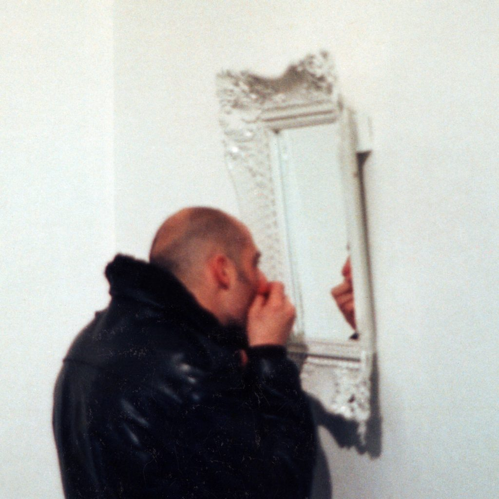 REPLYING MIRROR,  © 1997, plastic, varnishing, glass mirror, sound chip, 70 x 35 x 7 cm